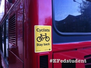 Cyclists stay back warns the poster on the back of a bus