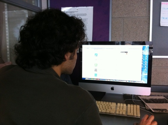 Neal from BA Journalism works on making a website in today's class