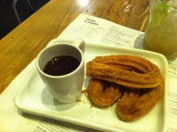 Chocolate pot and sugar coated churros...