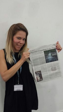 Taryn proudly holds up her article in the ALN